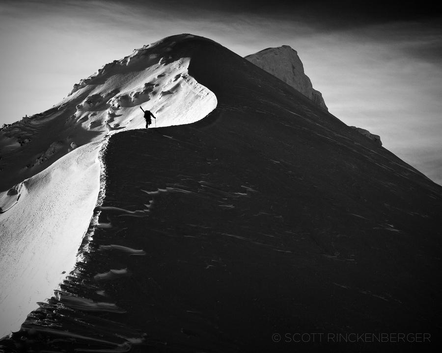 January-skier-climbing-Shadowed-ridge-Line-Chiwaukum-cascade-Mountains