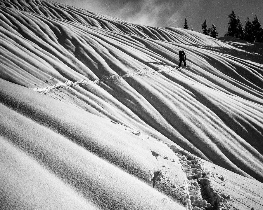 november-surreal-snowscape-skier-climber-tatoosh-range-landscape-mount-rainier