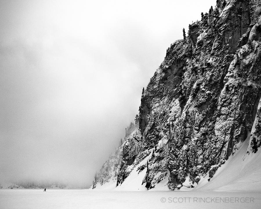 december-skier-crossing-frozen-snow-lake-washington-cascades-landscape