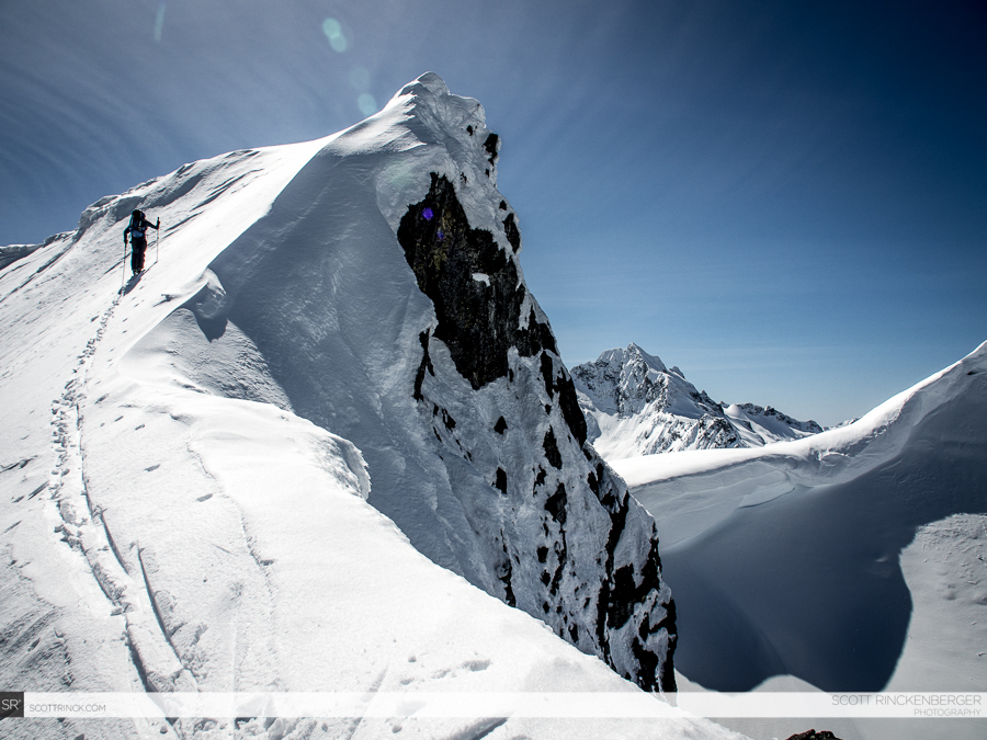 Brian Fletcher climbs a minor summit on the ridge above Cache Col.