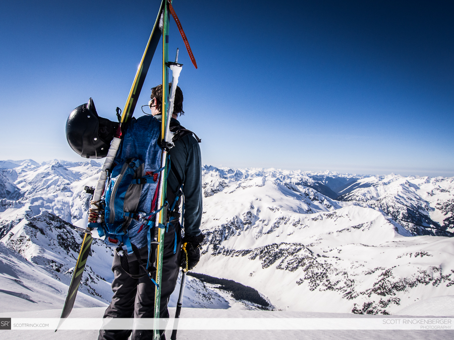 Brian Fletcher takes in the expansive views from the summit ridge of Spider Mountain.
