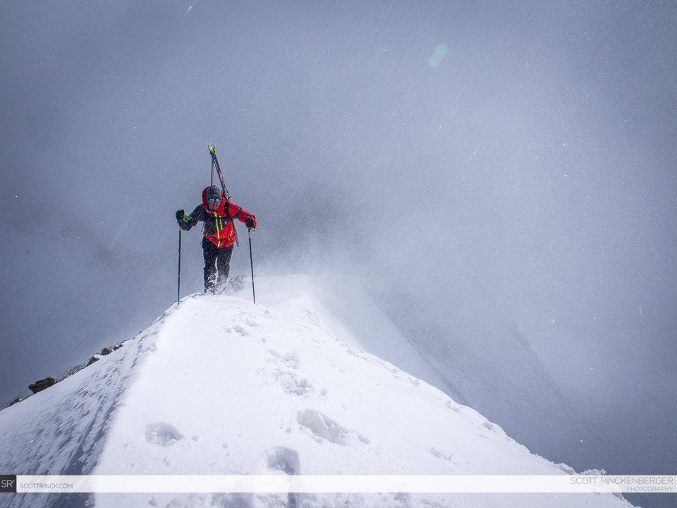 Chris Davenport climbing through weather on the summit ridge of Jones Mountain